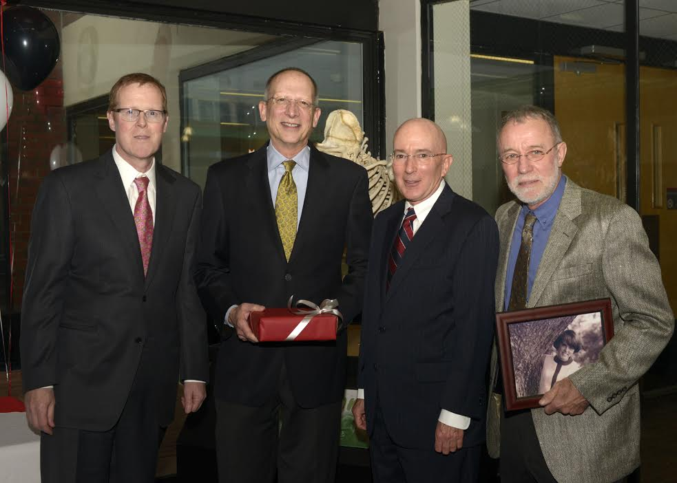 NC State College of Veterinary Medicine Dean Paul Lunn (far left) Jane Lewis Seaks Distinguished Professor Dr. Bruce Keene, benefactor Terry G. Seaks, and Professor Emeritus Dr. Clarke Atkins who holds a portrait photograph of Jane Lewis Seaks.