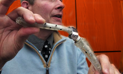 Veterinarian holding engineered joint hinge