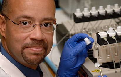 NC State CVM Professor Ronald Baynes conducting research
