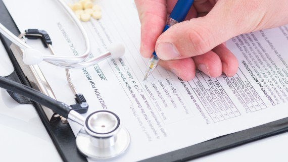 Person completing medical form