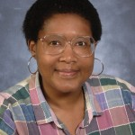 Portrait of woman in plaid shirt with glasses