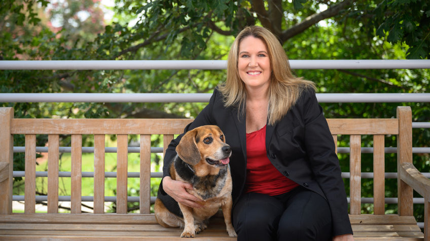 Danielle Pfaff, NC State Veterinary Hospital administrator, with her dog Trigger. Photo by John Joyner/NC State Veterinary Medicine